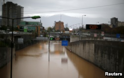 FILE - A view of a flooded highway access in Santiago, Chile, April 17, 2016.