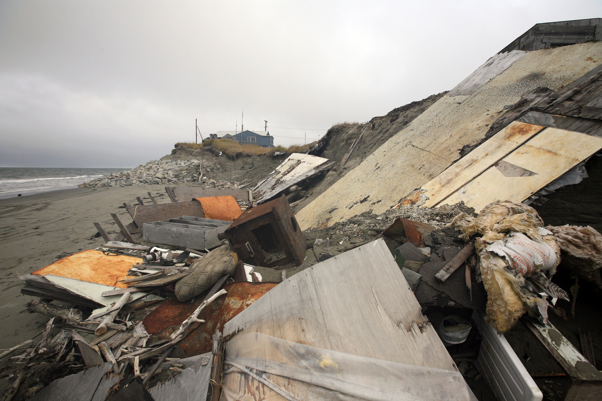Houses collapsed due to coastal erosion, Shishmaref, Alaska, US