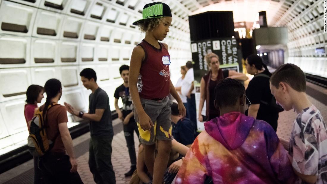 Kids suing Trump at DC Metro station