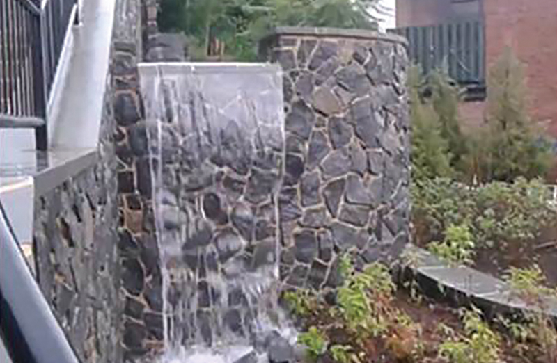 A waterfall helps to direct nutrient-laden runoff from storms into rain gardens. (Andy McLean, P.E - Water Resources Engineer)