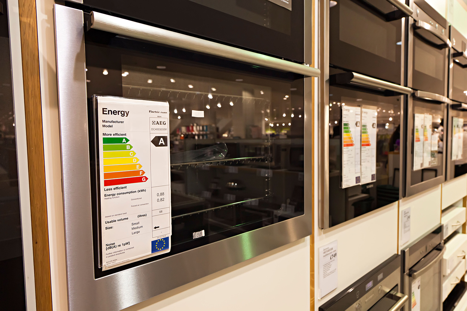 Energy efficiency rating on electric ovens in store UK.