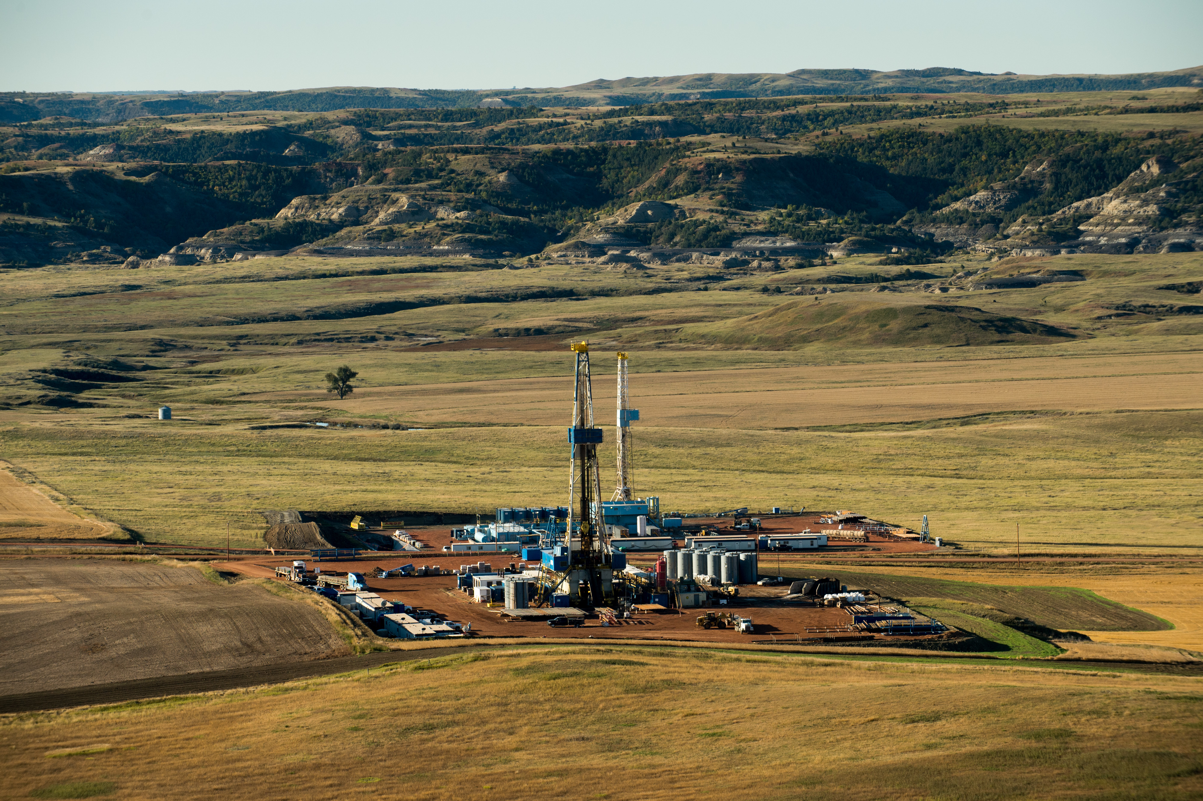 Photo of oil rigs sit just outside of Theodore Roosevelt National Park near Watford City, North Dakota.
