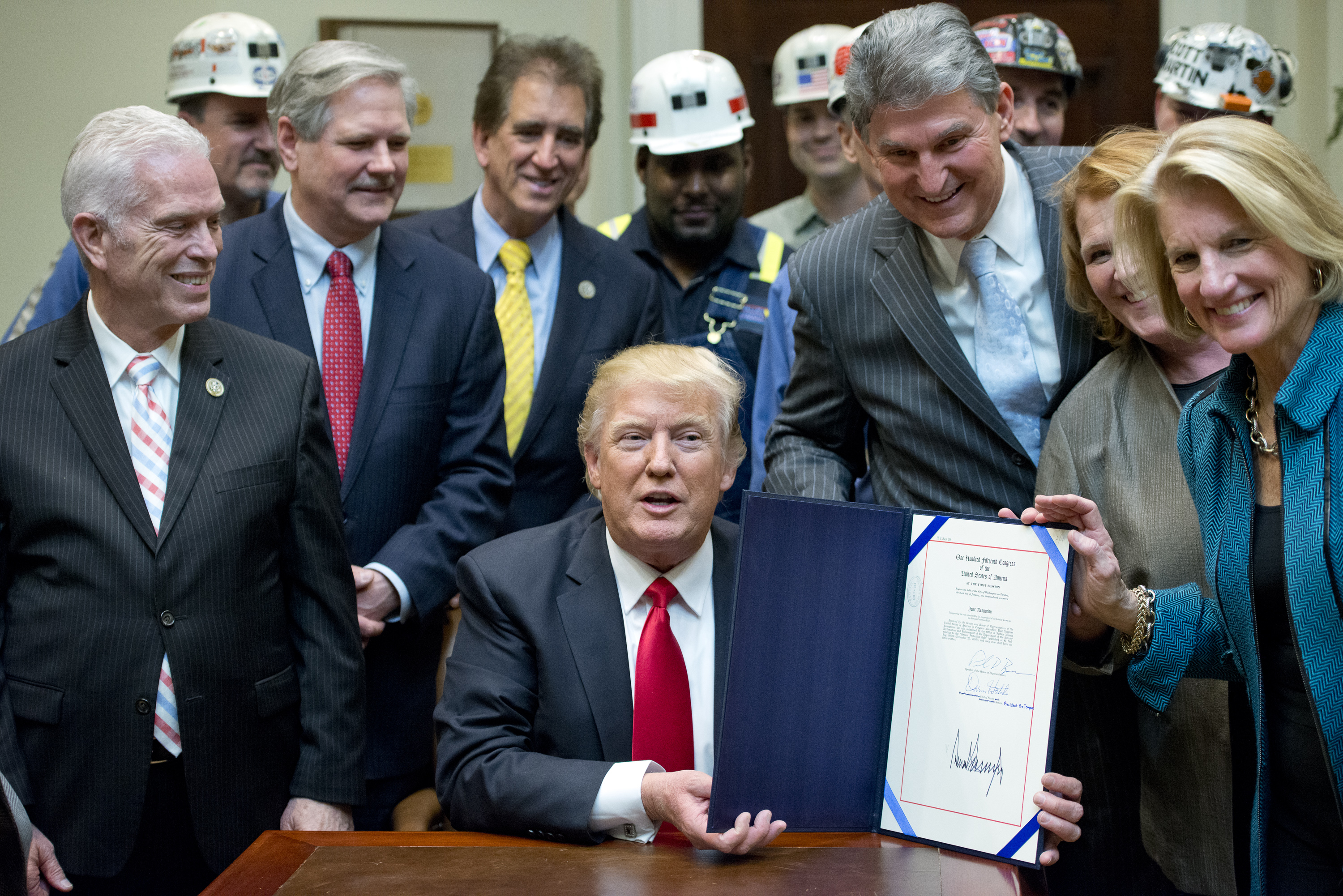 WASHINGTON, DC - FEBRUARY 16: U.S. President Donald Trump signs H.J. Res. 38, disapproving the rule submitted by the US Department of the Interior known as the Stream Protection Rule in the Roosevelt Room of the White House on February 16, 2017 in Washing
