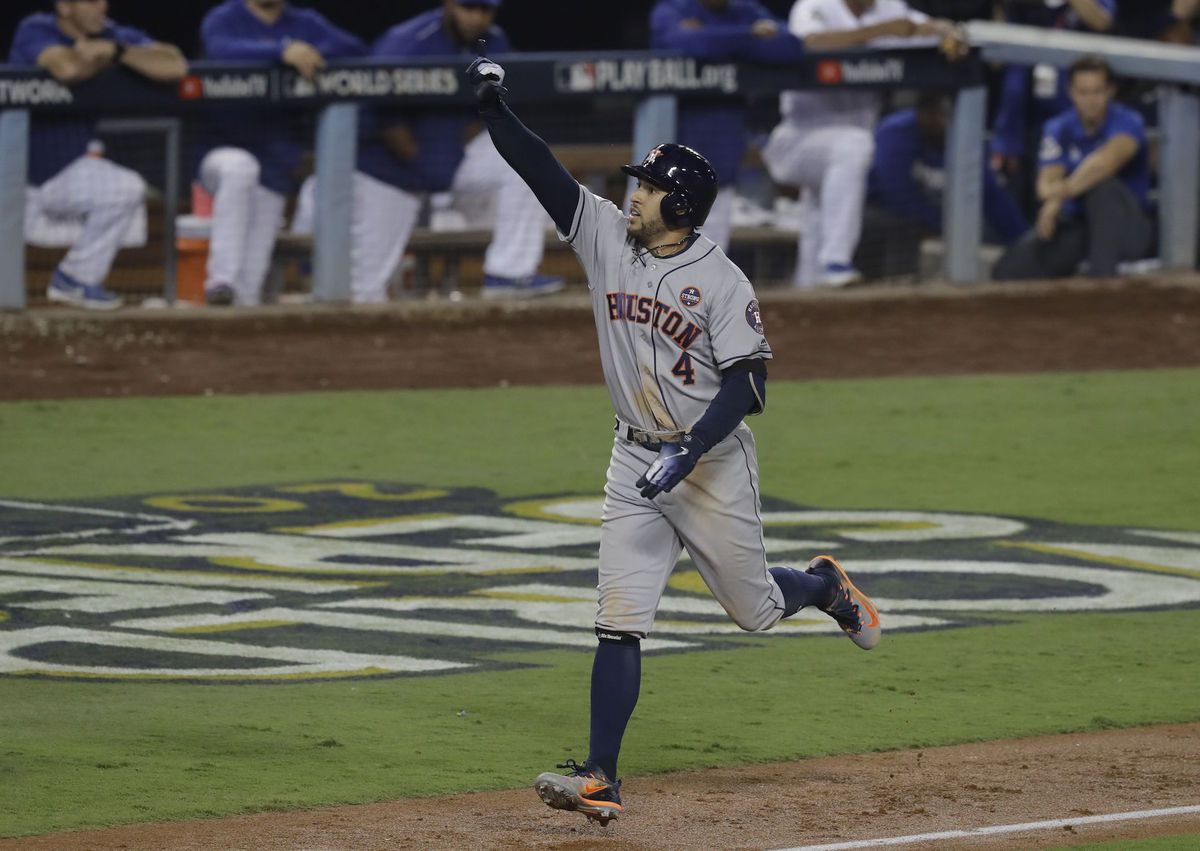 Houston Astros' George Springer celebrates after hitting a two-run home run.