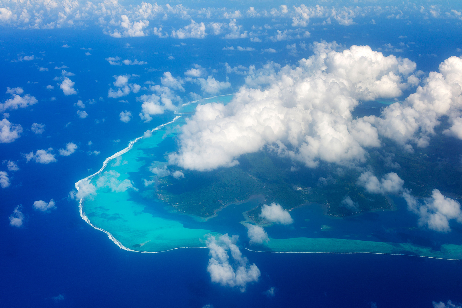 Climate sensitivity: View of Raiatea from the air with clouds. French Polynesia