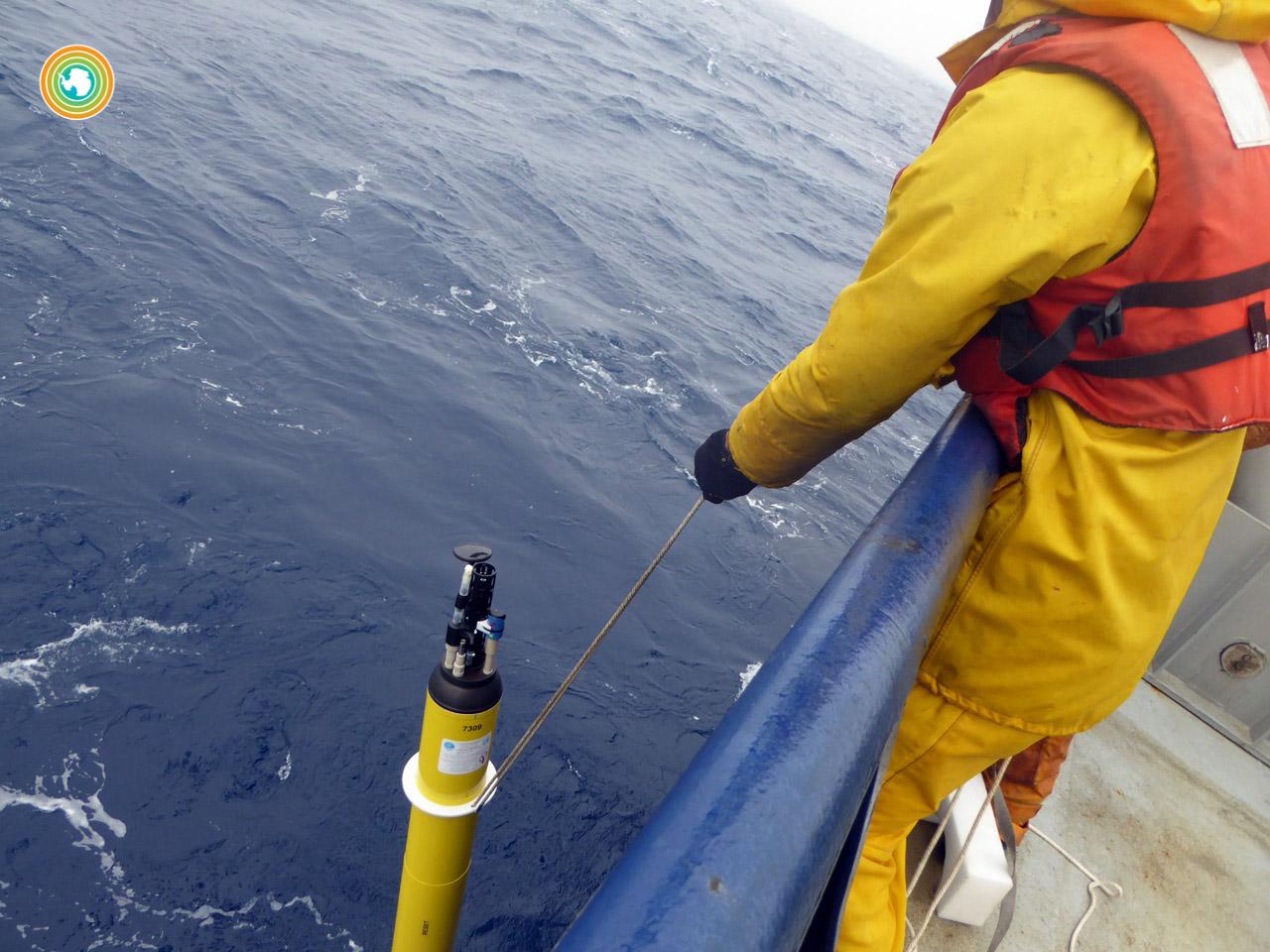 Researchers deploying an Argo float.