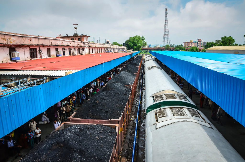 A coal train passes through a station in Jaipur, India. Credit: Sandra Foyt / Alamy Stock Photo. M4W32A