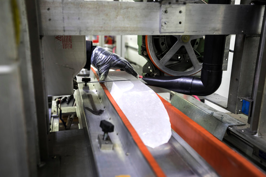 An ice core from Greenland is prepared for cutting at the National Ice Core Laboratory. Credit: Jim West / Alamy Stock Photo. K5B16Y