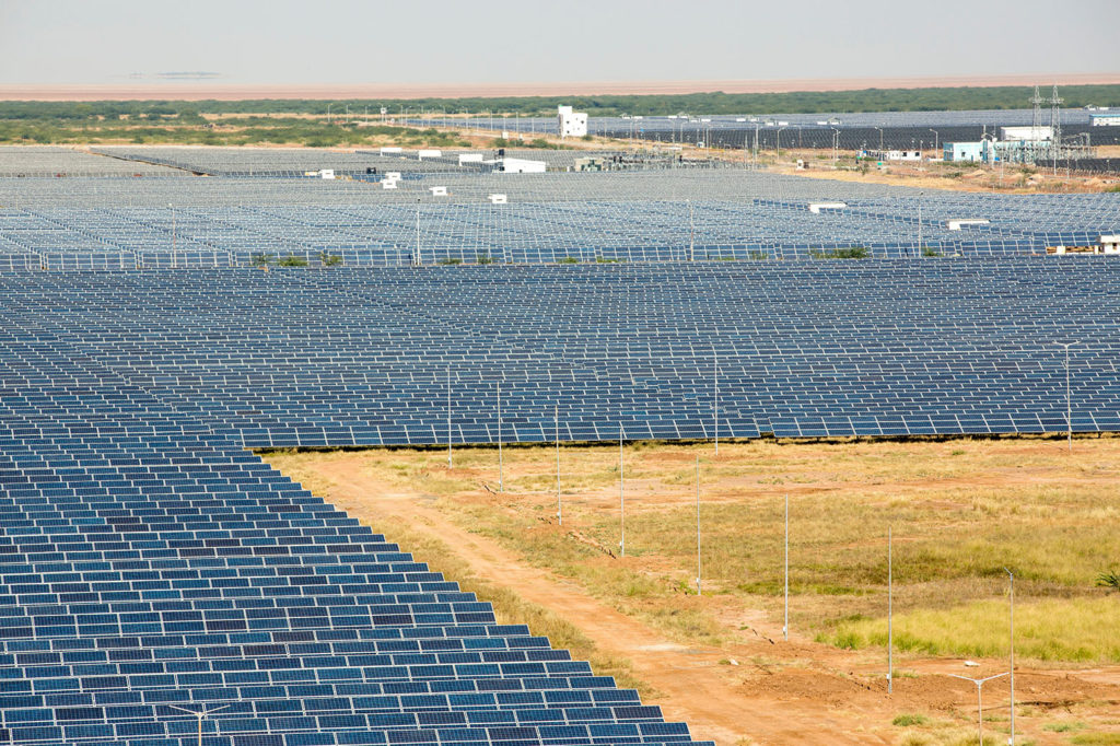 Gujarat Solar Park, in Gujarat, India, in 2013. It now has an installed capacity of 1637 MW. Credit: Ashley Cooper / Alamy Stock Photo. DRMTM7
