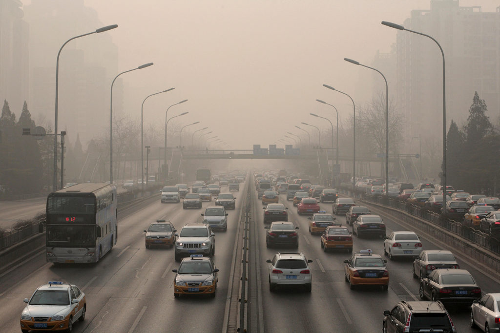 Heavy pollution over the second ring road on the east side of Beijing. Credit: David Gourhan / Alamy Stock Photo. HEG233