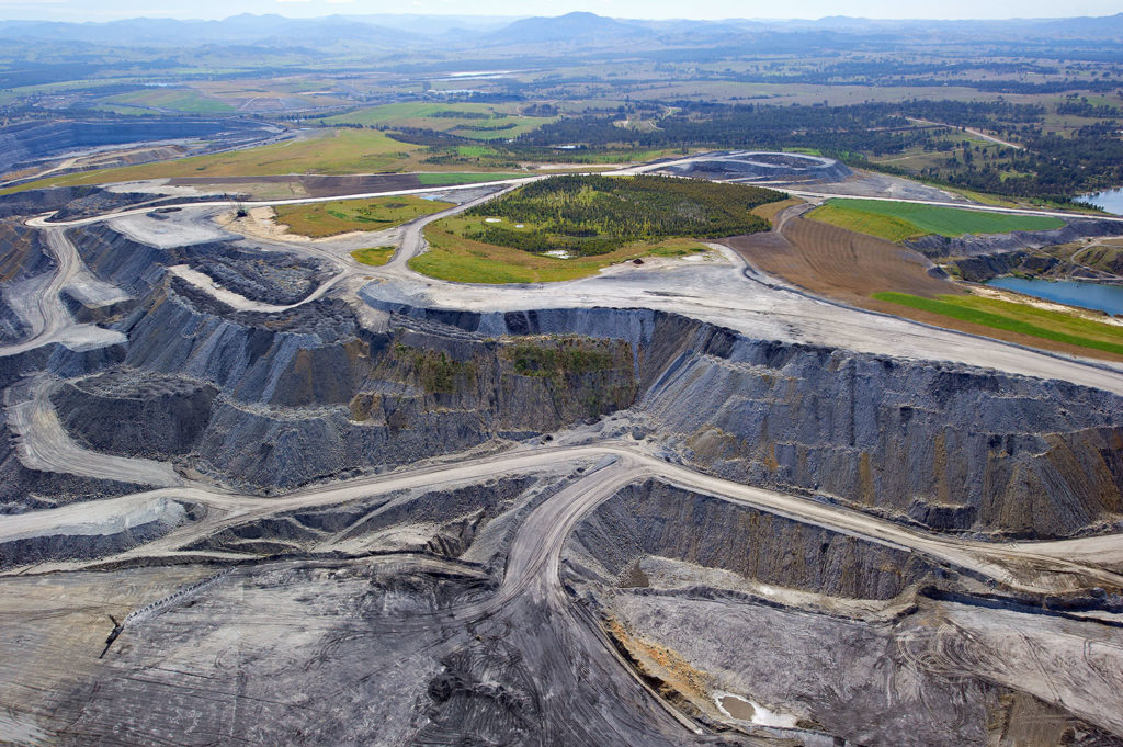 Aerial view of an open cut coal mine in Hunter Valley, New South Wales, Australia. Credit: redbrickstock.com / Alamy Stock Photo. C2MEXD