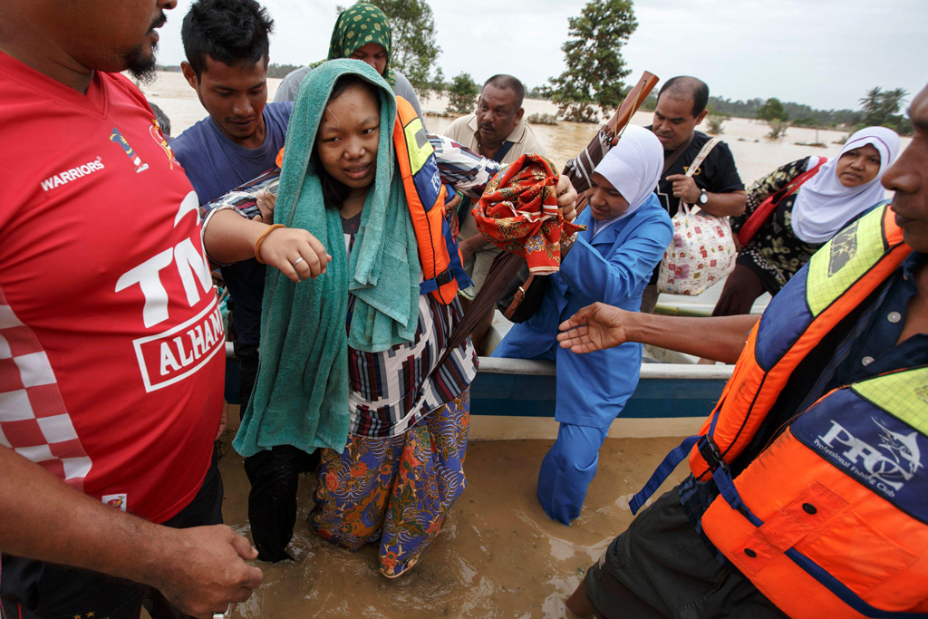 A-pregnant-woman-is-evacuated-from-her-home-by-rescue-workers-during-a-flood-in-Malaysia