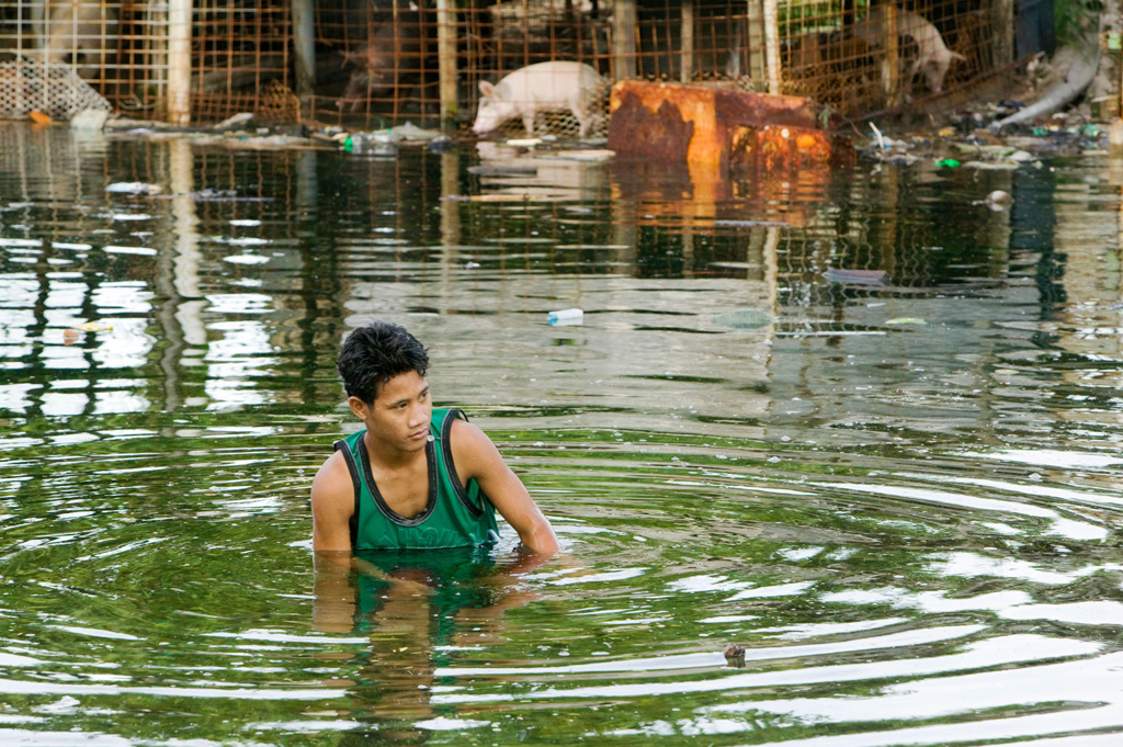 Man-in-water-as-low-lying-island-Funafuti-Atoll-is-flooded-by-sea-water