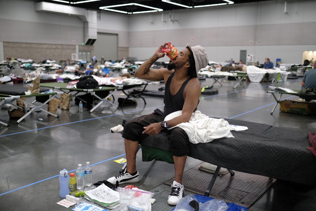Man cools off at a cooling shelter in Portland, Oregan