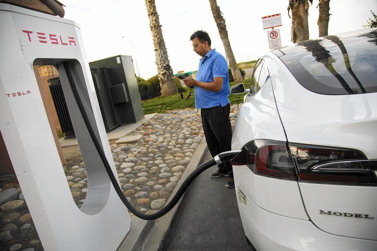 Gunjan Bagla of Cerritos charges his Tesla in Fresno County.
