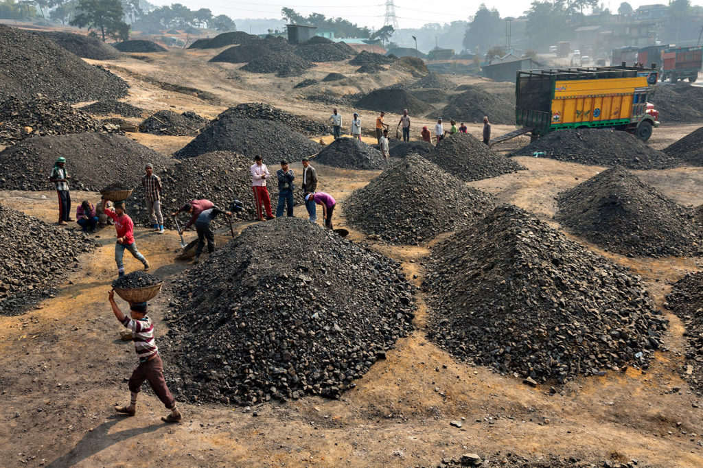 Coal being sorted by size and quality, Meghalaya, India. Credit: National Geographic Image Collection / Alamy Stock Photo. EB4DH0