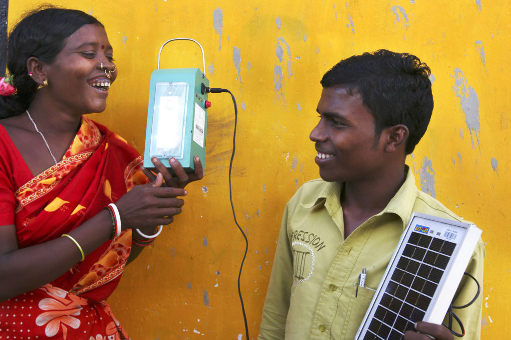 """A """"barefoot"""" solar engineer from Tinginaput, India, passes on her skills to other villagers teaching them how to make a solar lamp. Credit: Abbie Trayler-Smith / Panos Pictures / Department for International Development. (CC BY-NC-ND 2.0)"""