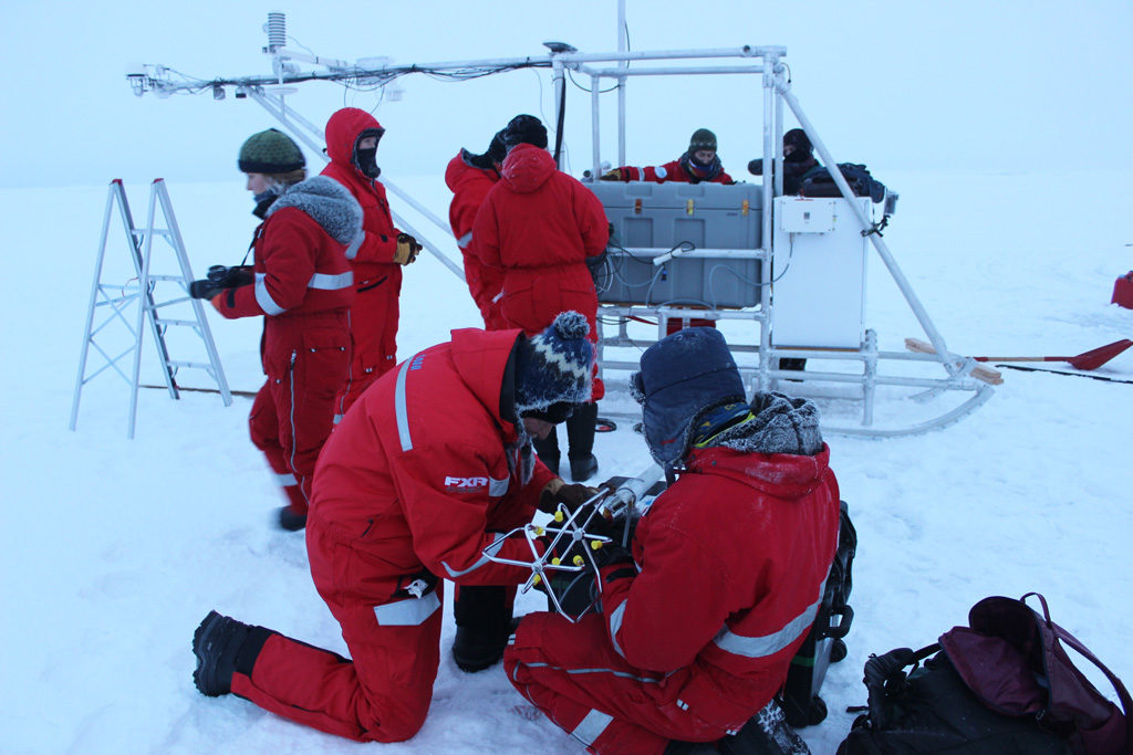 Dr Ola Perrson and a colleague attach a wind doppler to a scientific instrument in the Central Arctic Ocean. Credit: Daisy Dunne for Carbon Brief
