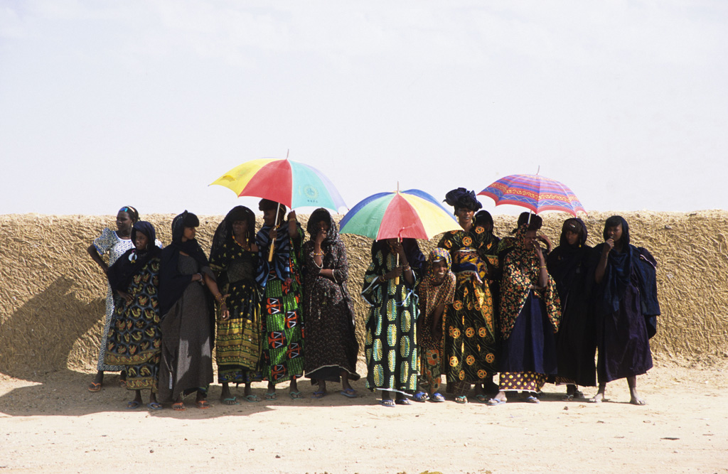 Nomad women sheltering from the sun Near Ingall Niger, West Africa.