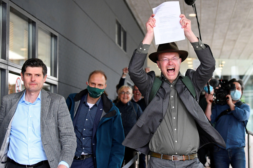 Donald Pols, Director of Friends of the Earth, holding a copy of a verdict in a case brought on against Shell by environmentalist and human rights groups